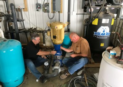 Mount technician and Goulds pump rep installing booster pump